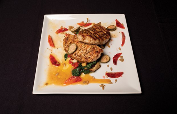 Grilled chicken breast over  sautéed spinach