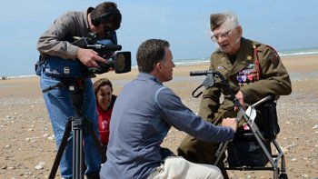 Doug Dunbar and his team filming Mr_ Blatnik's reaction to returning to his landing zone at Omaha Beach.jpg.jpe