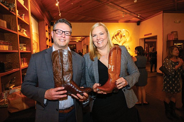 Ciccarino, Jason and Katie with raffle boots.jpg